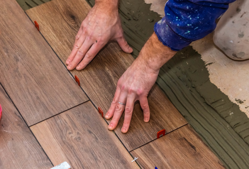 Person fixing wood floor