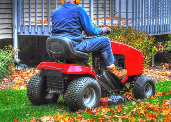 man riding on a lawn mower tractor